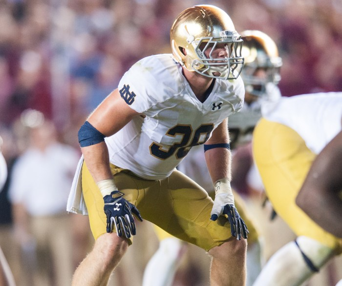 Senior linebacker Joe Schmidt readies for the snap during the Oct. 18 loss to Florida State. Schmidt suffered a season-ending injury Saturday against Navy.