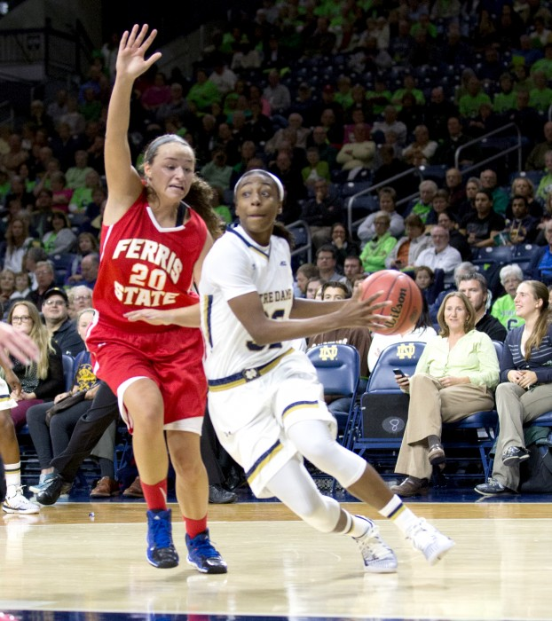 Irish junior guard Jewell Loyd cuts by a Ferris State defender during Notre Dame's 92-32 rout over the Bulldogs on Wednesday night. The game was Notre Dame's only exhibition contest of the season.