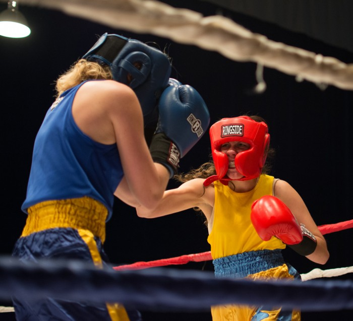 """Senior Val """"Valiswag"""" Williams unleashes a hook during her unanimous decision victory over sophomore Mercedes """"Merciless"""" De la Rosa in the semifinal round Tuesday night in Joyce Center Fieldhouse."""