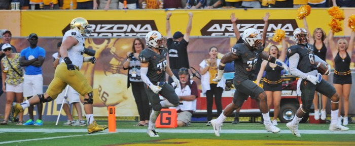 Arizona State redshirt junior defensive back Lloyd Carrington scampers into the end zone with a 58-yard interception return for a touchdown in the fourth quarter of the Sun Devils' 55-31 win.