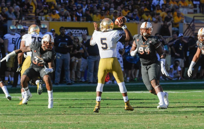 Senior quarterback Everett Golson drops back to pass during Notre Dame's 55-31 loss Saturday at Arizona State. Golson has turned the ball over 17 times in the last six games, including five times Saturday.