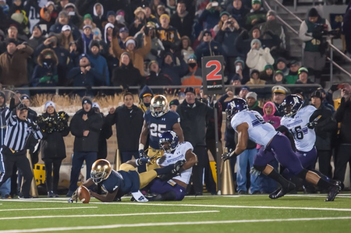 Irish junior receiver Chris Brown coughs up a fumble near the goal line during Notre Dame's 43-40 overtime loss to Northwestern on Saturday at Notre Dame Stadium.