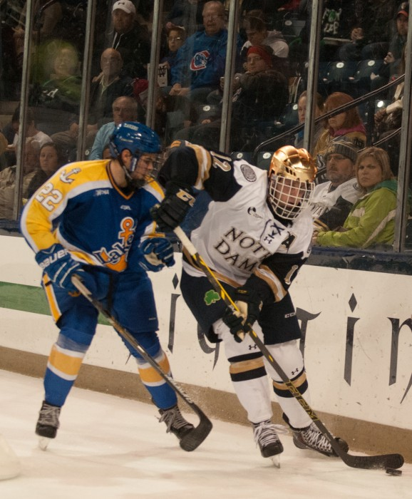 Irish junior winger Sam Herr shields the puck during Notre Dame's 5-3 win over Lake Superior State on Oct. 17.