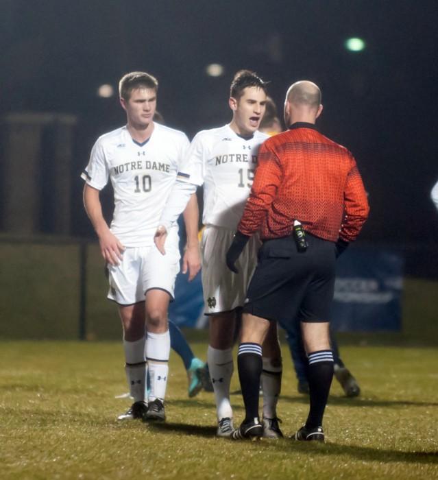 Irish sophomore defender Brandon Aubrey (left) and junior midfielder Evan Panken confront the referee following Notre Dame's 1-0 defeat to Virginia in the NCAA tournament Sunday at Alumni Stadium.