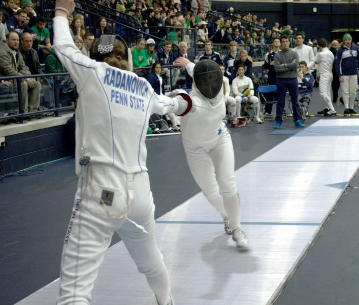 Irish junior Catherine Lee, right, competes during the DiCicco Duals on Feb. 8 at Purcell Pavilion. Lee finished second in the epee.