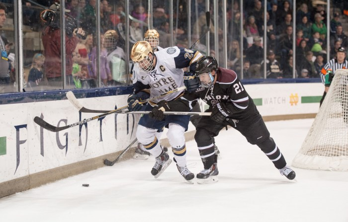 Irish junior center and captain Steven Fogarty sheds a Union defender during Notre Dame's 3-2 overtime loss at Compton Family Ice Arena.