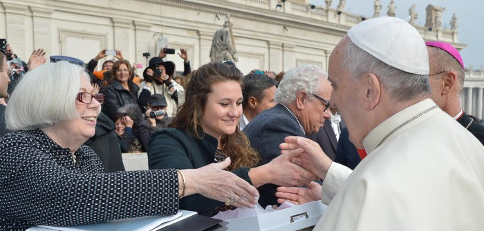Saint Mary's College President, Carol Ann Mooney (left), and senior Kristen Millar shake hands with Pope Francis as they deliver the 225 letters from Catholic women across the United States on Nov. 26.