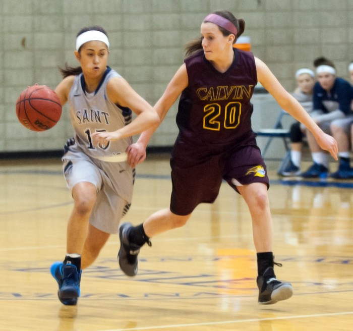 Belles sophomore guard Heather Pesigan brings the ball up the court during a 95-68 loss to Calvin on Jan. 15.
