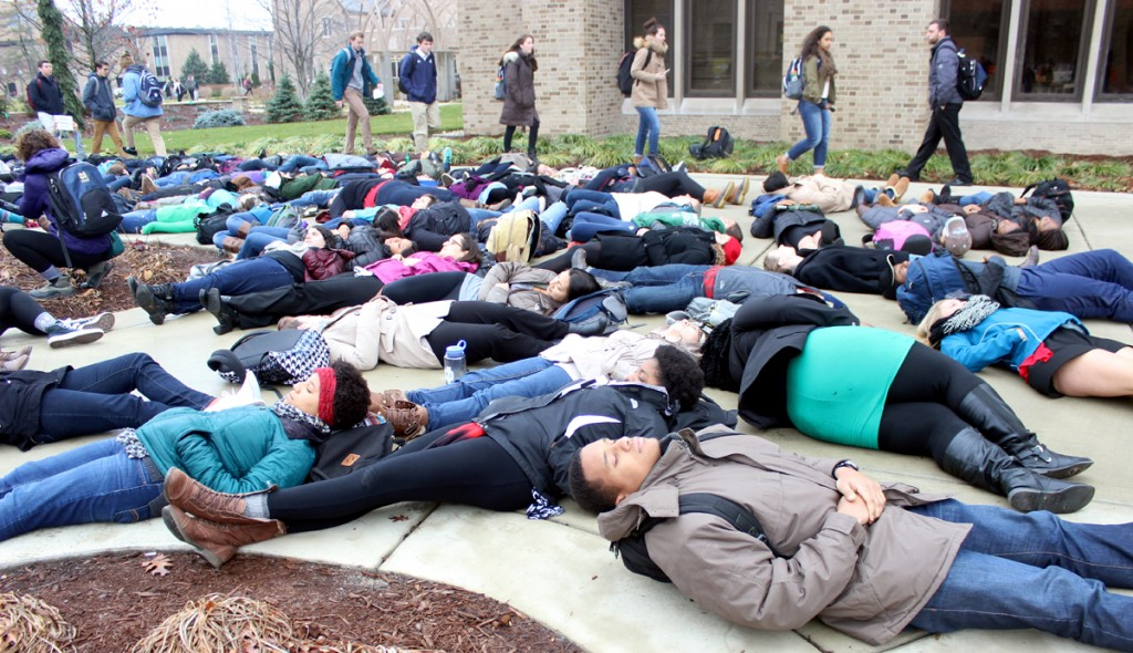 "Students and members of the Notre Dame community cover the space in between O'Shaughnessy and DeBartolo Halls in a ""die-in"" Tuesday, part of a demonstration against police brutality and racial injustice."