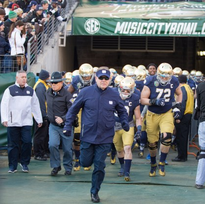 Irish coach Brian Kelly leads the team out of the tunnel in LP Field in Nashville, Tennessee.