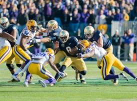 Irish quarterback Malik Zaire attempts to evade LSU defenders.