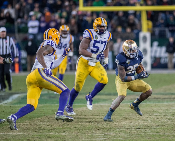 Irish running back Tarean Folston evades two LSU defenders in Notre Dame's 31-28 win over the Tigers on Tuesday. Folston rushed for 73 yards on 21 carries in the victory.