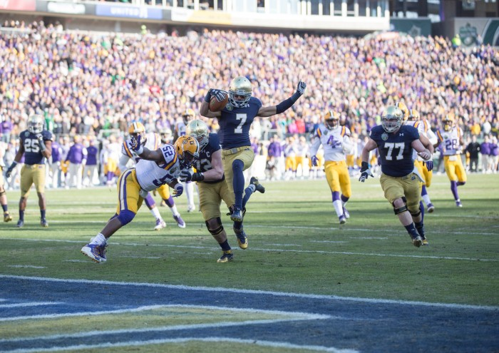 Irish sophomore receiver Will Fuller leaps across the goal line in the first quarter of Notre Dame's 31-28 victory over LSU in the Music City Bowl on Tuesday. Fuller caught his 15th touchdown pass of the season Tuesday, tying a program single-season record.