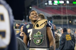 The Franklin American Mortgage Music City Bowl trophy is carried off the field.