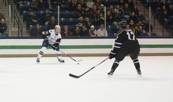 Irish freshman center Connor Hurley looks to pass to a teammate during Notre Dame's 3-2 overtime loss to Union College on Nov. 28 at Compton Family Ice Arena. Hurley has three goals and seven assists this year.