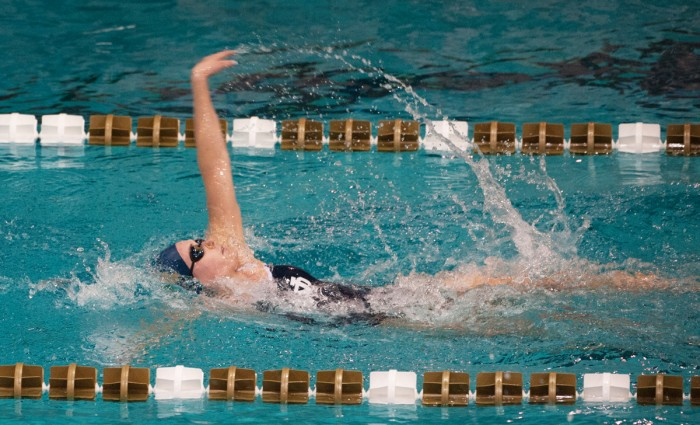 Irish junior Catherine Galletti powers through the middle of the 100-yard backstroke during Notre Dame's 219-60 win over Valparaiso on Nov. 15, 2013.