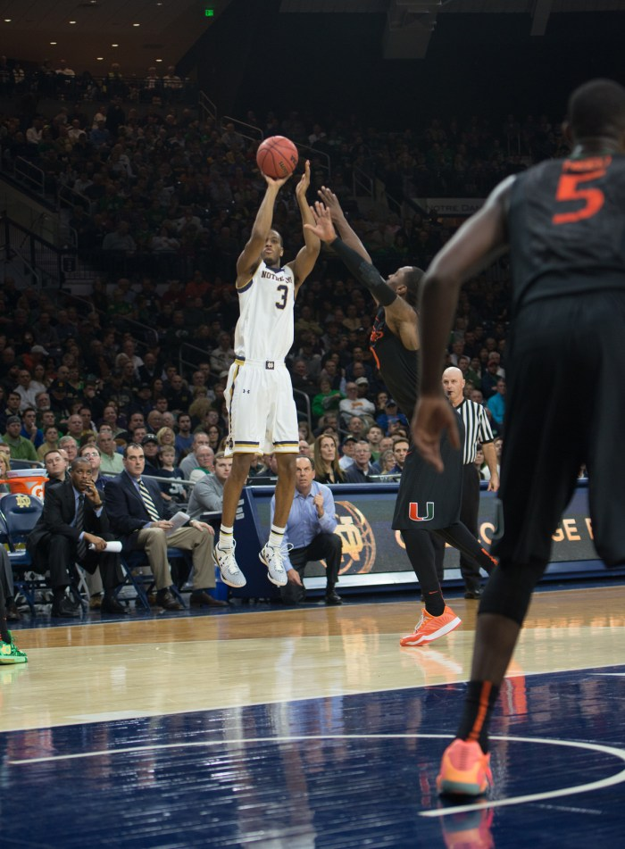 Irish sophomore forward V.J. Beachem shoots a three-pointer during Notre Dame's 75-70 win over Miami on Saturday at Purcell Pavilion.