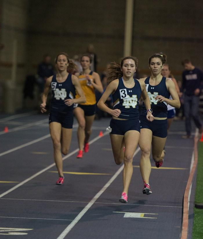 Irish junior Danielle Aragon, left, and freshman Jessica Harris run in the 1,000-meter run during the Blue and Gold Invitational on Dec. 14.