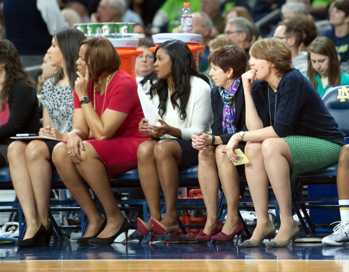 Irish assistant coach Niele Ivey, center, sits courtside during Notre Dame's 89-76 win over Georgia Tech on Jan. 22 at Purcell Pavilion.