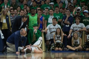 Irish captain Pat Connaughton lies on the floor after falling on his head. Michael Yu   The Observer