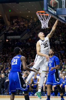 Junior forward Zach Auguste makes a layup. Auguste had 14 points for the night. Jodi Lo   The Observer