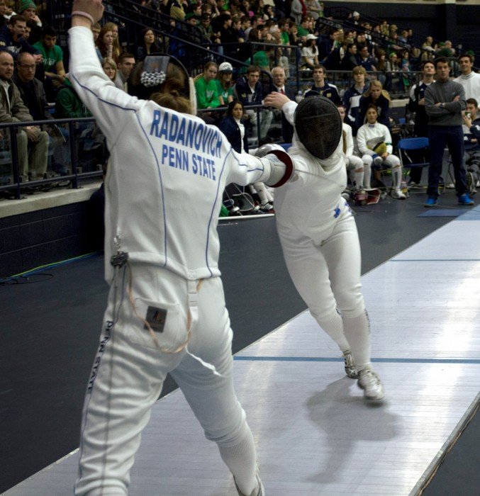 Irish junior epeeist Catherine Lee thrusts at Penn State  sophomore Jessie Radanovich during last year's       DeCicco Duels at the Castellan Family Fencing Center on Feb. 8. ND defeated the Nittany Lions, 14-13.