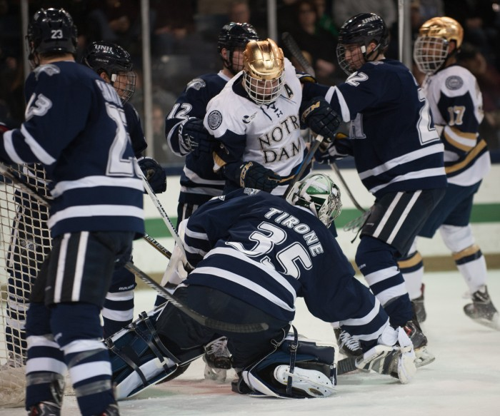 Irish senior right winger Peter Schneider scraps during Notre Dame's 5-2 loss to New Hampshire on Compton Family Ice Arena on Jan. 30.