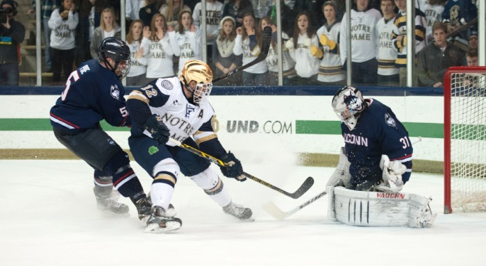 Irish junior left wing Sam Herr crashes the net during Notre Dame's 3-3 tie with UConn on Jan. 16 at Compton Family Ice Arena. Herr has tallied eight goals and six assists on the season for the Irish.