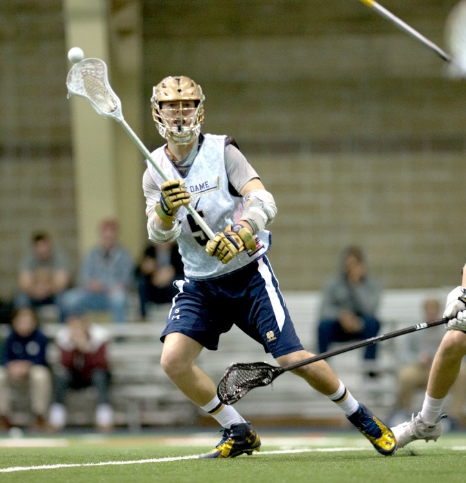 Irish graduate student midfielder Jim Marlatt passes during Notre Dame's exhibition match against Bellarmine on Jan. 25.