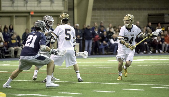 Irish freshman attack Mikey Wynne (24) makes a run during Notre Dame's 14-12 win over Georgetown on Feb. 14 at Loftus Sports Center.