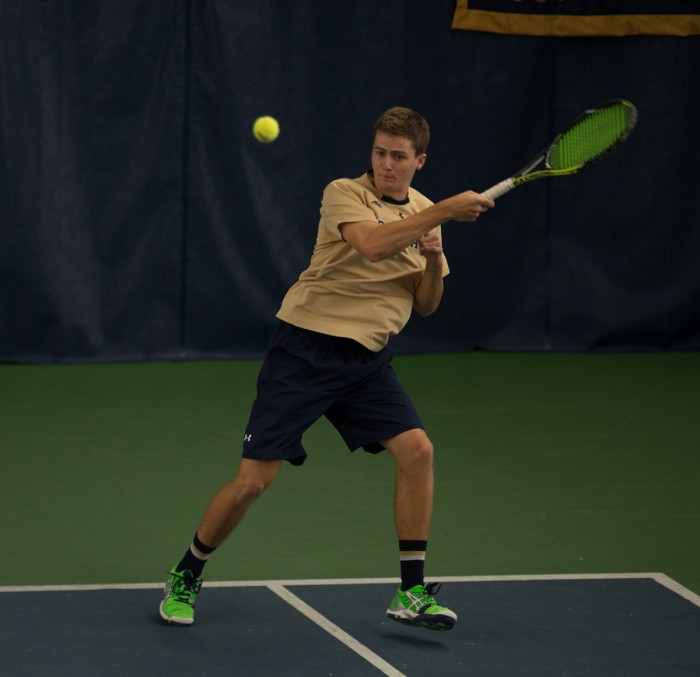 Irish junior Quentin Monaghan hits a backhand in Notre Dame's 4-3 win over Oklahoma State on Jan. 24 at Eck Tennis Pavilion. Monaghan and junior Eric Schnurrenberger won their doubles match against Ohio State.