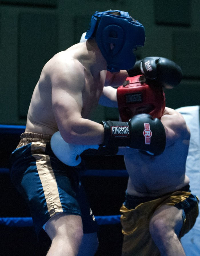 Senior Bryan Cooley, left, defends an attack from graduate student C.J. Pruner during Tuesdays' 184-pound semifinal bout.