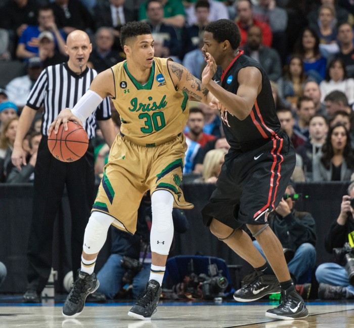 Irish junior forward Zach Auguste dribbles into the post against a defender during Notre Dame's 69-65 win over Northeastern at CONSOL Energy Center in Pittsburgh on Thursday.
