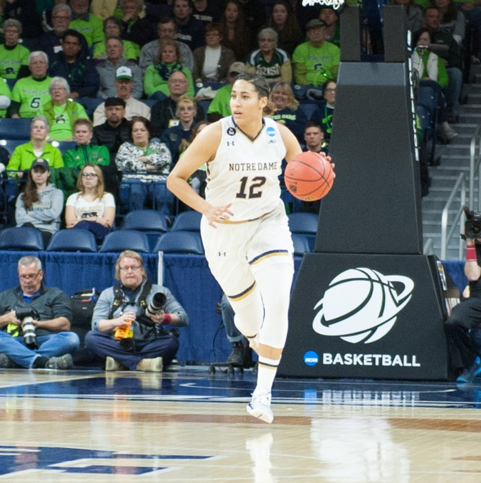 Irish sophomore forward Taya Reimer brings the ball up the court during Notre Dame's 79-67 win over DePaul on Sunday at Purcell Pavilion.