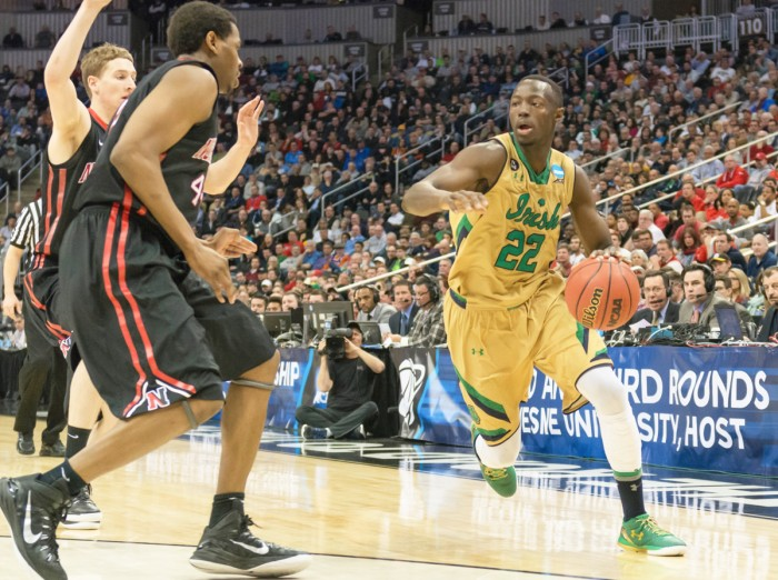 Irish senior guard Jerian Grant drives around a Northeastern defender during Notre Dame's 69-65 win to advance to the third round of the NCAA Tournament on March 19.