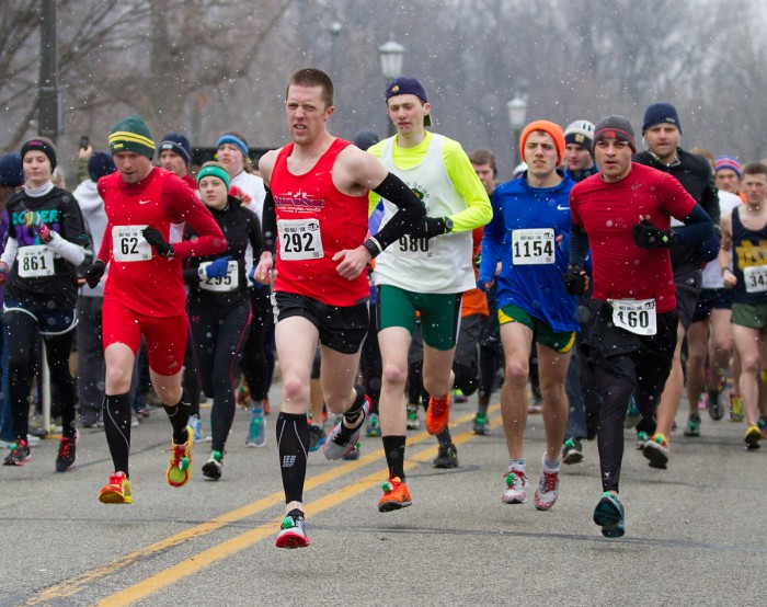 Students participating in last year's Holy Half brave the cold and snow to ultimately finish the race's 13.1 miles.