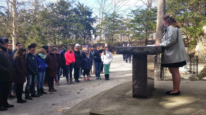Students gather at the Grotto Friday to pray for victims of sexual violence and for an end to sexual assault on campus.