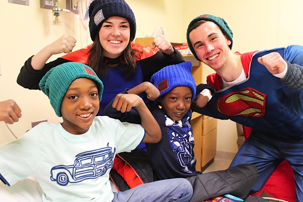 b5f85b8a1a1 Notre Dame students visit Memorial Hospital in South Bend to give hats to  children battling cancer