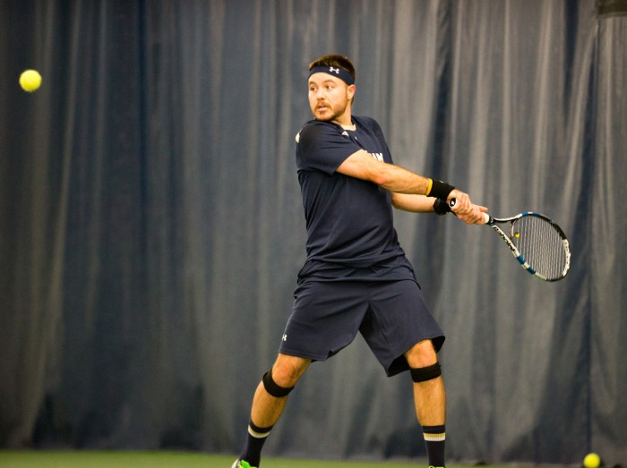 Senior Billy Pecor hits a backhand during Notre Dame's 4-3 win over Oklahoma State on Jan. 24 at Eck Tennis Pavilion.