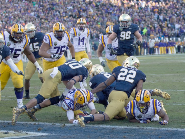 Irish safeties junior Max Redfield, 10, and senior Elijah Shumate, 22, tackle an LSU ballcarrier at the goal line during Notre Dame's 31-28 win in the Music City Bowl on Dec. 30.