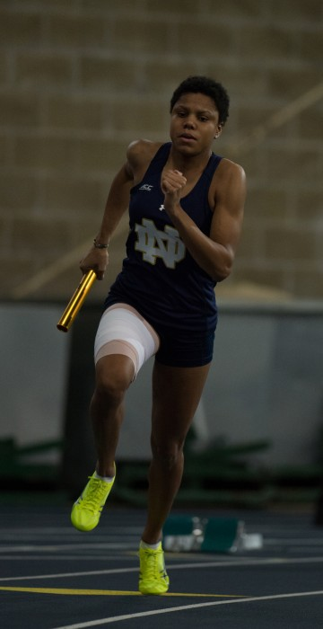 Irish freshman Parker English carries the baton in the 4x400-meter relay during the Meyo Invitational on January 24 at Loftus Sports Center.