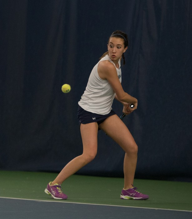 Irish junior Julie Vrable prepares a back-hand stroke in a 6-1 loss to Stanford on Feb. 6 at the Eck Tennis Pavilion.