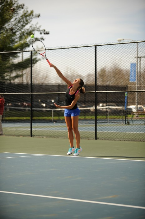 Belles senior Kayle Sexton starts a rally during Saint Mary's 8-1 win over Adrian on April 14 at Saint Mary's Tennis Courts.