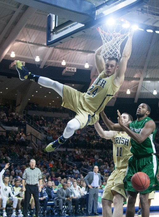 Irish senior Pat Connaughton swings after a dunk against Stetson on Nov. 10, 2013.