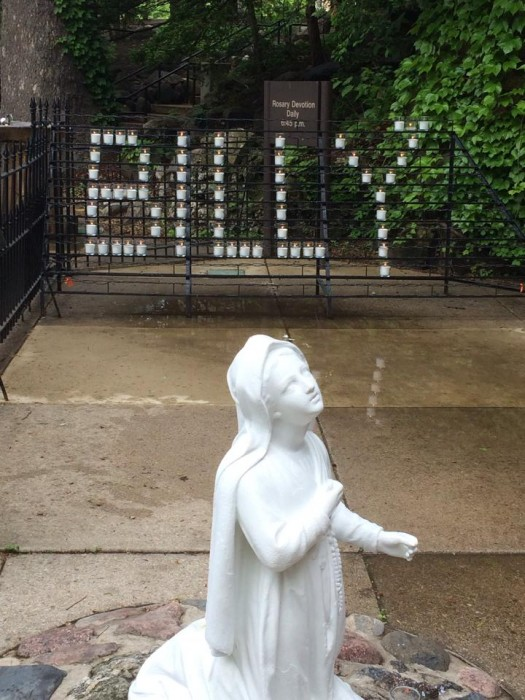 """Candles at the Grotto are arranged to spell """"Billy"""" in honor of Billy Meckling who  died early Saturday."""
