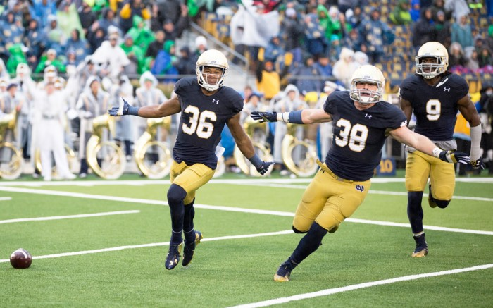 Irish junior cornerback Cole Luke, left, graduate student linebacker Joe Schmidt, center, and junior linebacker Jaylon Smith celebrate during Notre Dame's 17-14 win over Stanford at Notre Dame Stadium on Oct. 4.
