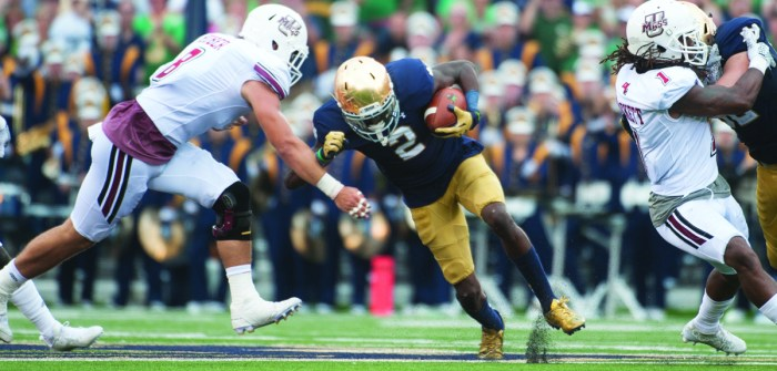 Senior receiver Chris Brown tries to power past Massachusetts redshirt sophomore linebacker Shane Huber during Notre Dame's 62-27 victory over the Minutemen last Saturday at Notre Dame Stadium.