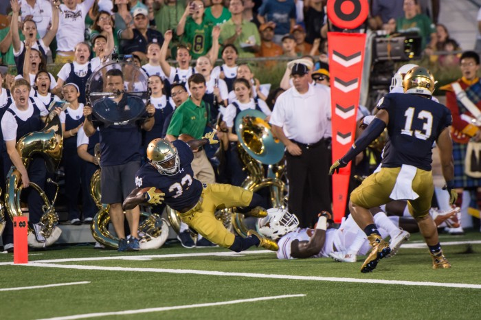 Irish freshman running back Josh Adams dives for the goal line during Notre Dame's 38-3 win over Texas on Saturday.