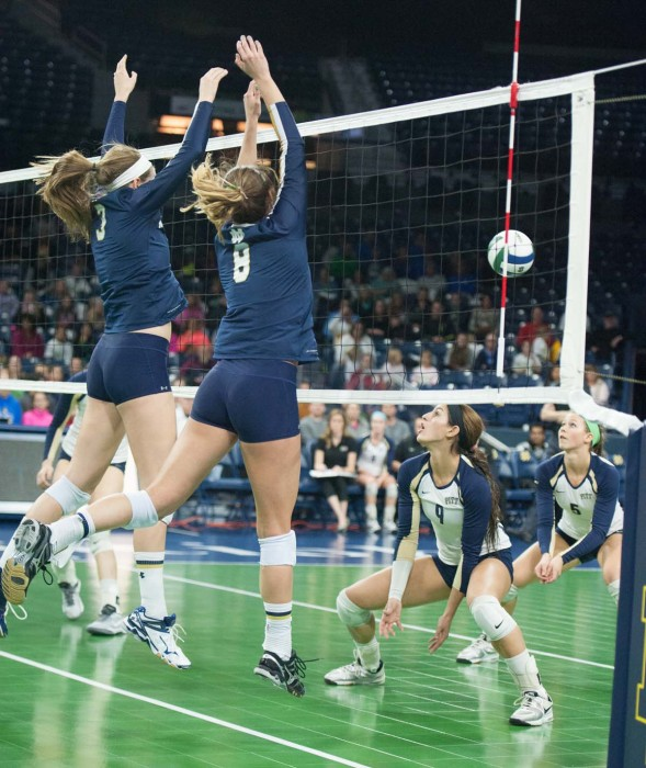 Notre Dame sophomores outside hitter Sam Fry (left) and setter Maddie Dilfer jump during a 3-0 loss to Pittsburgh on Nov. 28 at Purcell Pavilion.