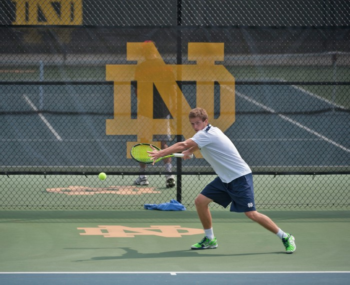 Senior Quentin Monaghan winds up for a hit during a 4-3 victory over North Carolina State on April 18 at Eck Tennis Pavilion.